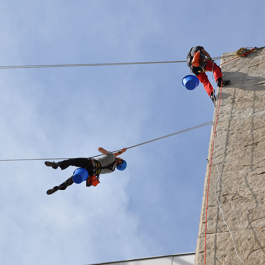 Rope access banner installation